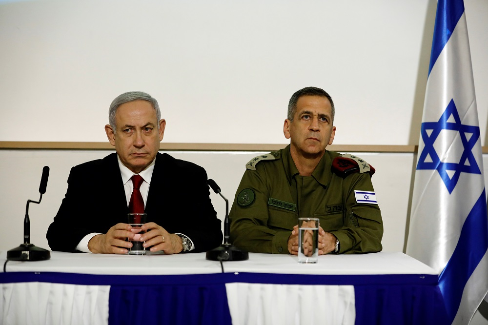 Israel's Prime Minister Benjamin Netanyahu and Israel's Chief of Staff Aviv Kochavi sit together as they deliver joint statements in Tel Aviv, Israel November 12, 2019. REUTERS/Corinna Kern