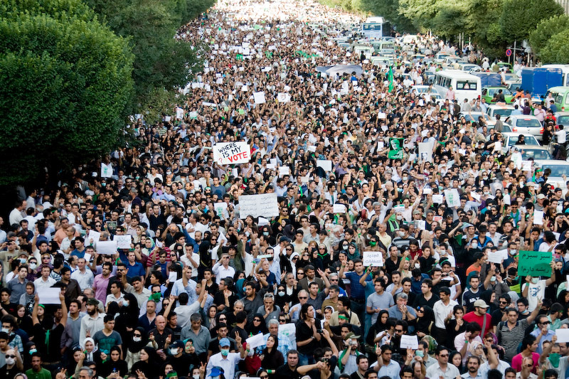 EDITORS' NOTE: Reuters and other foreign media are subject to Iranian restrictions on leaving the office to report, film or take pictures in Tehran.    Protesters march during a silent demonstration against the results of the Iranian presidential election in central Tehran June 18, 2009. Tens of thousands of Iranians, wearing black and carrying candles, marched on Thursday to mourn those killed in mass protests against a presidential election they and defeated Iranian presidential candidate Mirhossein Mousavi say was rigged.   REUTERS/Demotix  (IRAN CONFLICT ELECTIONS POLITICS IMAGES OF THE DAY) - GM1E56J01GS01