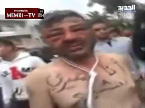 Manifestación en Tripoli a favor de Assad